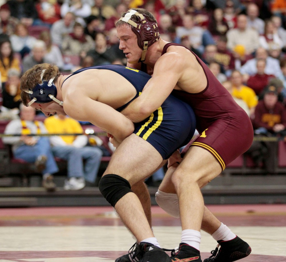Gophers' Senior Sonny Yohn wrestles Michigan's Max Huntley during Jan. 27 dual at the Sports Pavilion.