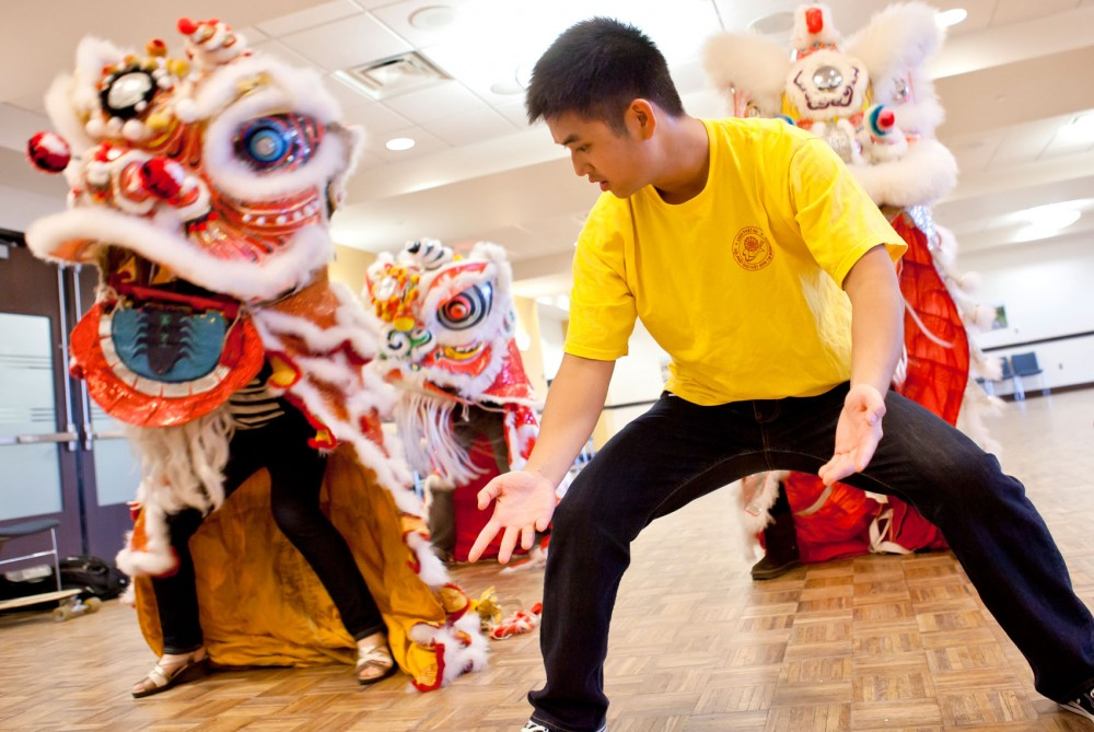 Volunteer Chris Nguyen teaches event attendees how to properly hold and perform the traditional Chinese lion dance at Coffman Union on Monday. The Asian-American Student Union is a hosting a Spring Conference that is running until Saturday the 14th.