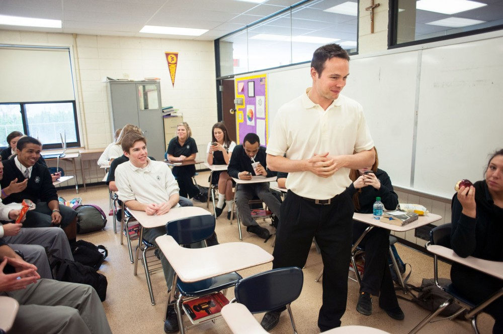 Former Gophers hockey star John Pohl talks with his homeroom class Friday at Cretin-Derham Hall in St. Paul. Pohl, who helped lead Minnesota to the 2002 national championship, now teaches business classes to high school students.