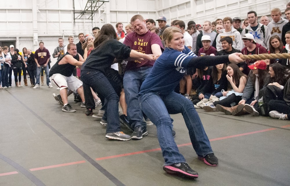 Kappa Kappa Gamma senior Saidee Duffy competes in Spring Jam's opening tug-of-war competition Monday night at the Field House.  The Field House was home to Campus Carnival, Spring Jam's predecessor.