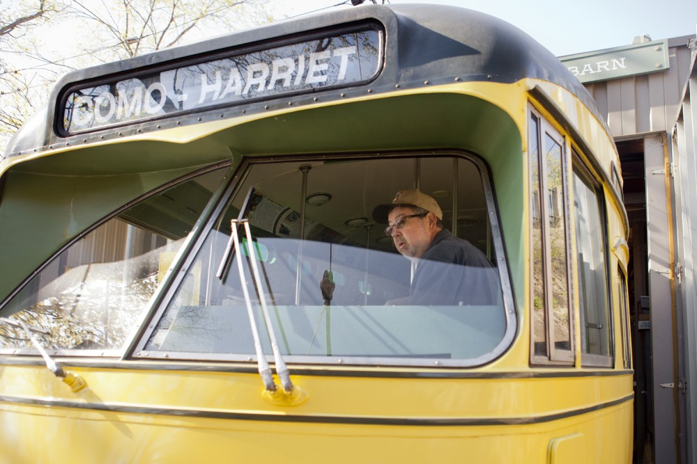 Aaron Isaacs, historian for the Minnesota Street Car Museum, operates a mile-long stretch of streetcar line along Lake Harriet along with other volunteers. Streetcars run throughout the summer.