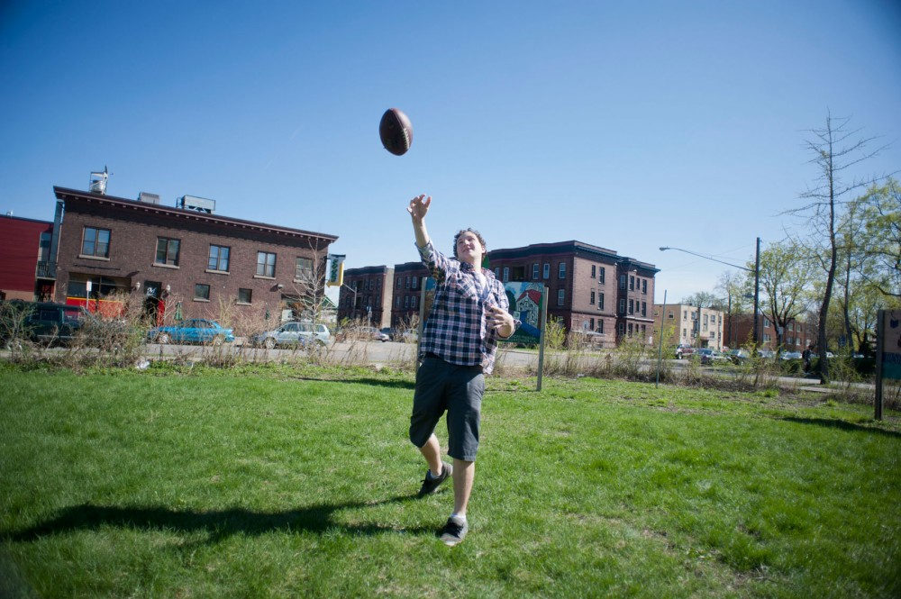 Communications major and neighborhood renter Ben Elling and a friend enjoy a warm spring afternoon Tuesday in the vacant lot on the corner of Eighth Avenue and Fourth Street SE.  A new apartment complex has been proposed for the site.