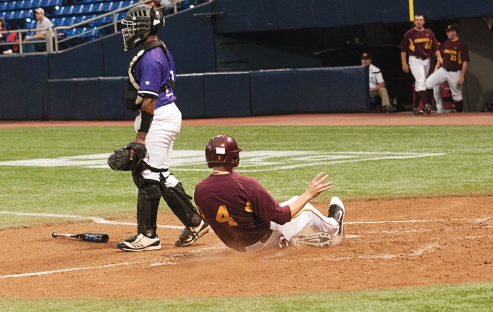 Gophers third baseman Kyle Geason slides home during Sunday's game against Northwestern University at the Metrodome. Geason was 1-for-4 with an RBI in his return from a wrist injury.