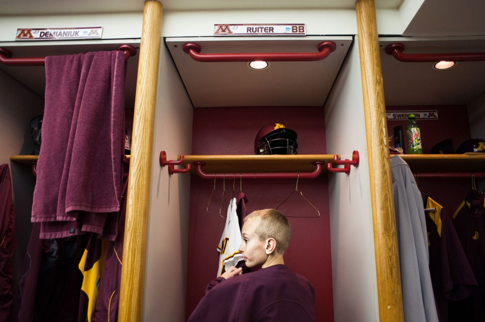 Eight-year-old Griffin Ruiter hangs his Gophers uniform in his locker in the Gophers clubhouse Saturday at the Metrodome.  Ruiter serves at the teams bat boy.