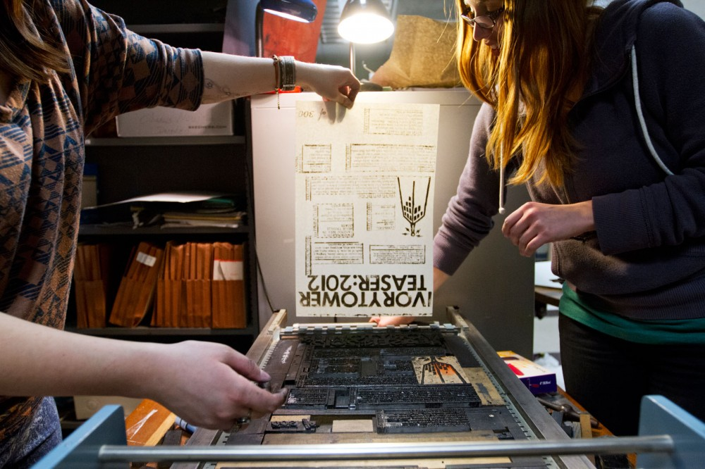 A handmade teaser poster, one of 300, is pulled from the letterpress on Monday night in the basement of Lind hall for the teaser release of the Ivory Tower magazine.