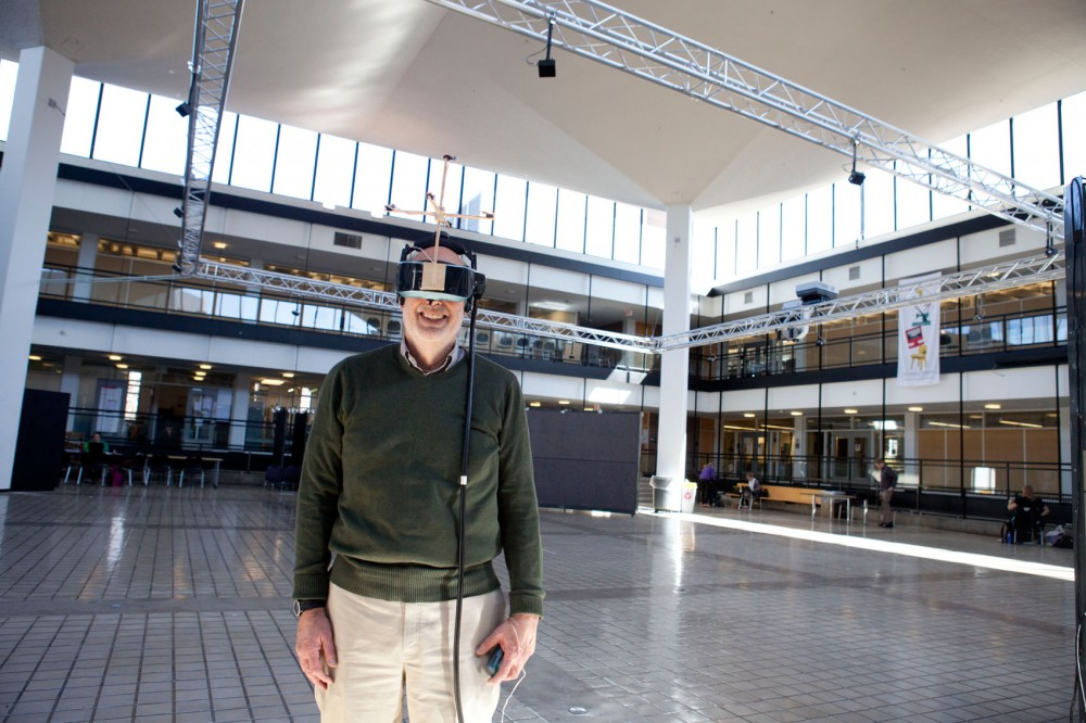 Architecture associate professor Lee Anderson poses, sporting his virtual reality headset. Anderson collaborated with others to create a wireless virtual courtyard that College of Design students can walk through and experience in real time.
