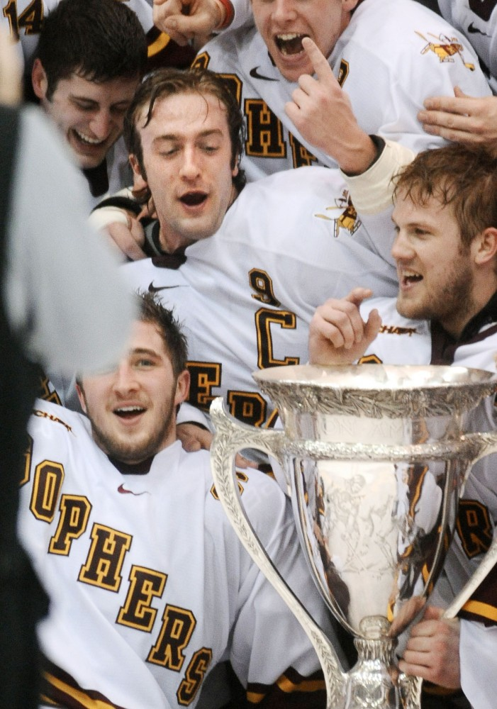 Taylor Matson celebrates with his teammates after Minnesota wins the MacNaughton Cup on March 3. It was the first MacNaughton Cup title since 2007.