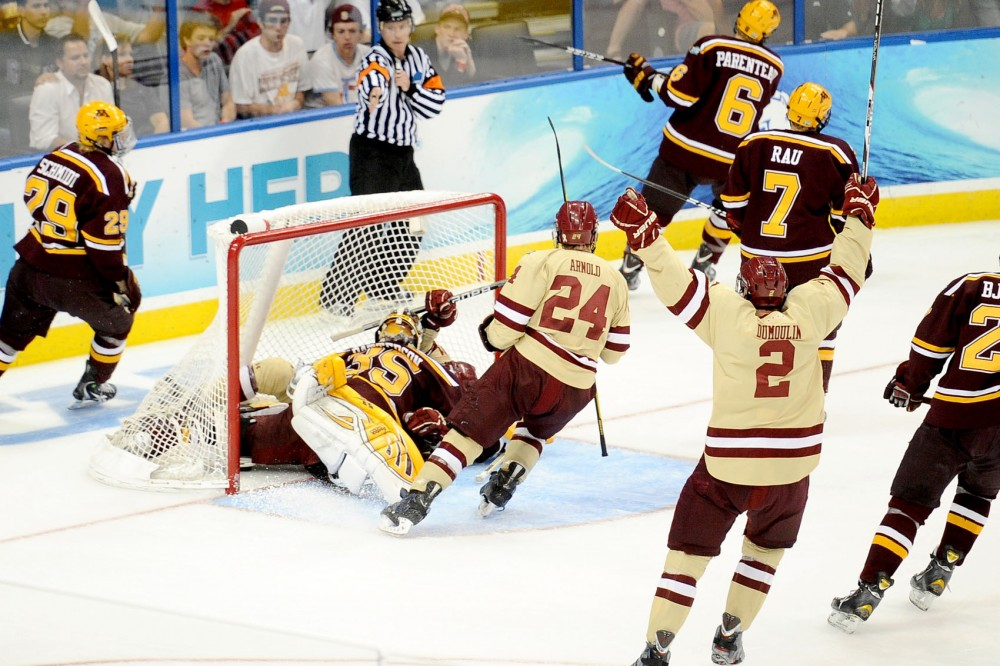 Boston College's Chris Kreider scores the Eagle's third goal against Minnesota during Thursday's NCAA tournament semifinal game in Tampa, Fla. Boston College went on to win the national title by beating Ferris State 4-1 on Saturday.