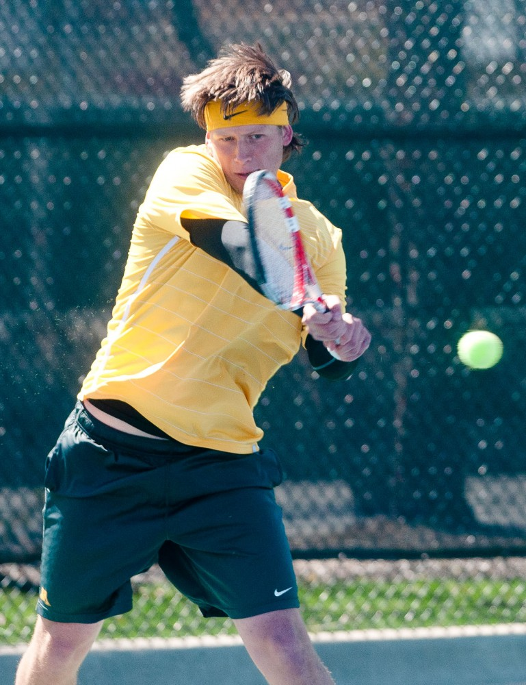 Freshman Leandro Toledo returns the ball with a strong backhand Sunday at Baseline Tennis Center. Toledo lost 2-6, 6-1, 6-1 to No. 12 Chase Buchanan of Ohio State.