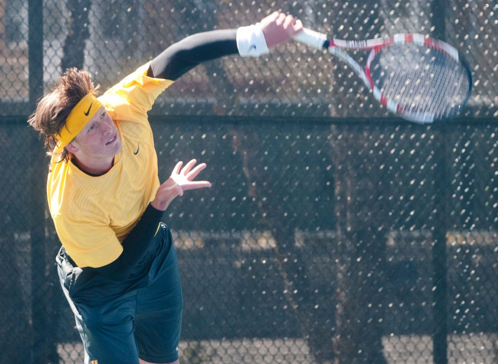 Freshman Leandro Toledo returns the ball Sunday at Baseline Tennis Center.