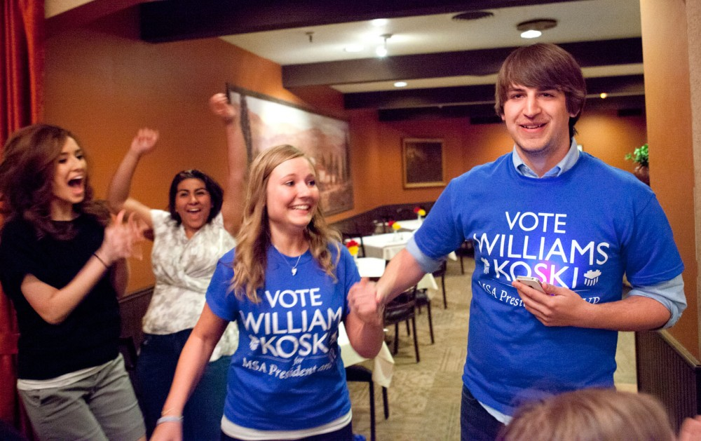 Newly elected MSA president Taylor Williams, right, and vice president Jilian Koski celebrate as they announce their victory on Wednesday night at Vescio's Italian Restaurant in Dinkytown.