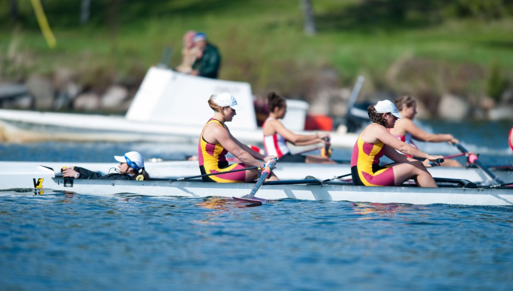 Minnesota's first varsity four rows against Wisconsin on Sunday morning on Lake Phalen in St. Paul, Minn.  The boat finished four seconds ahead of Wisconsin.