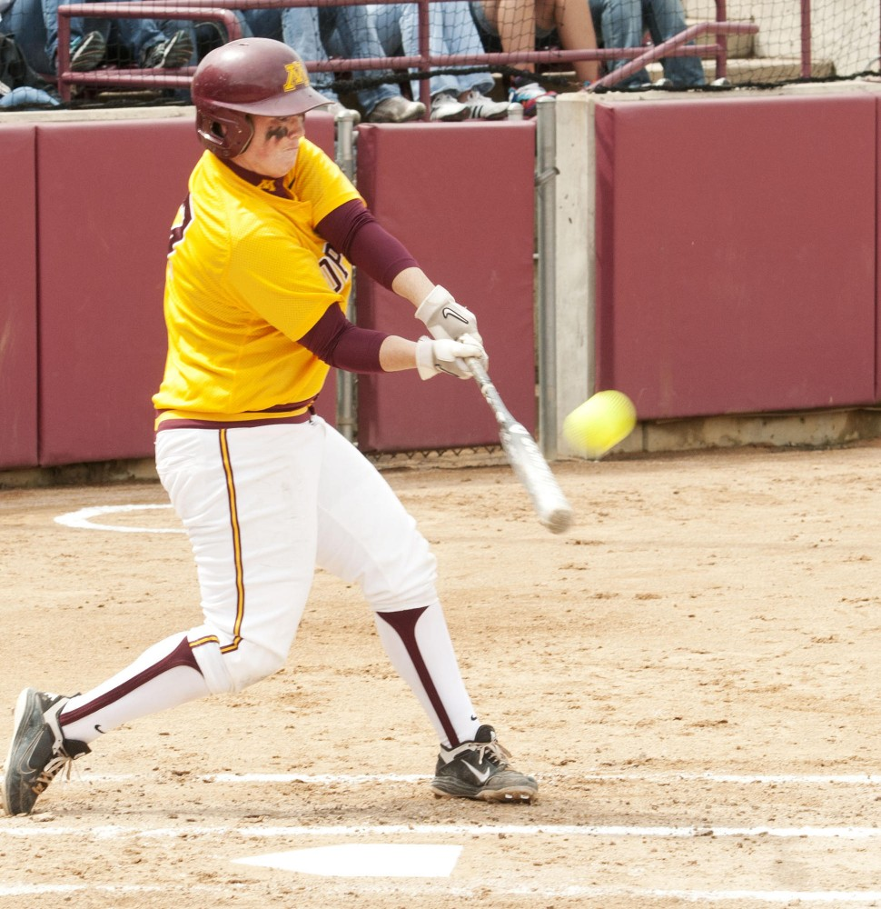 Gophers catcher Kari Dorle hits Sunday against the University of Michigan at the Jane Sage Cowles Stadium. Dorle hit a three-run home run in the first inning of Sunday's game.