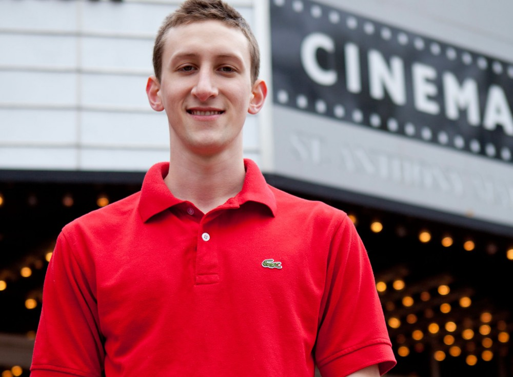 Evan Kail, a senior Japanese major, poses in front of the Saint Anthony Main Theatre on Friday. Many organizations have critically recognized Kail's screenplays through film festivals across the country. Kail plans on pulling resources from local talent to make Minneapolis a major contender in the world of cinema.