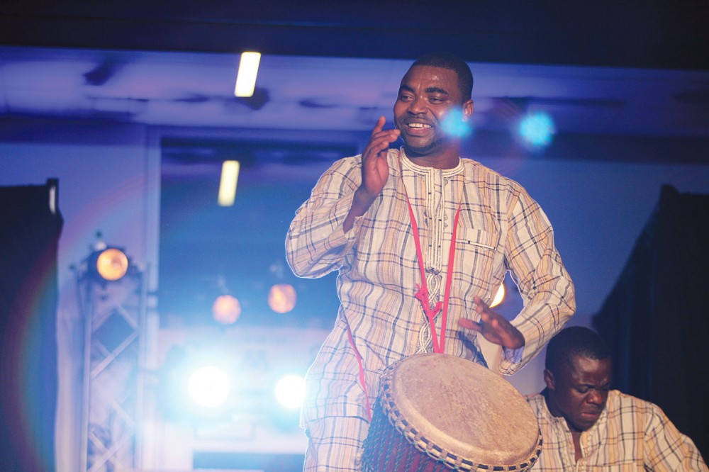 Titambe West-African drummer preform before the beginning of the fashion show Saturday evening at TCF Bank Stadium. The African themed event raised money for the Smile Networks reconstructive surgeries in Africa.