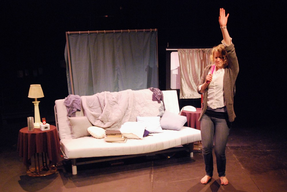 "Sophomore Nicole Kopfmann rehearses a scene Sept. 19, 2011, in ""Stop Kiss,"" one of seven student productions in the Xperimental Theatre's 2011-2012 season."