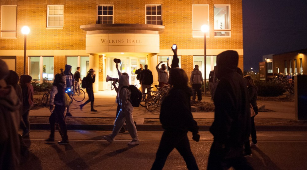 Protesters march down University Avenue in Dinkytown following Thursday's rally. The march temporarily blocked Fourth Street and University Avenue.