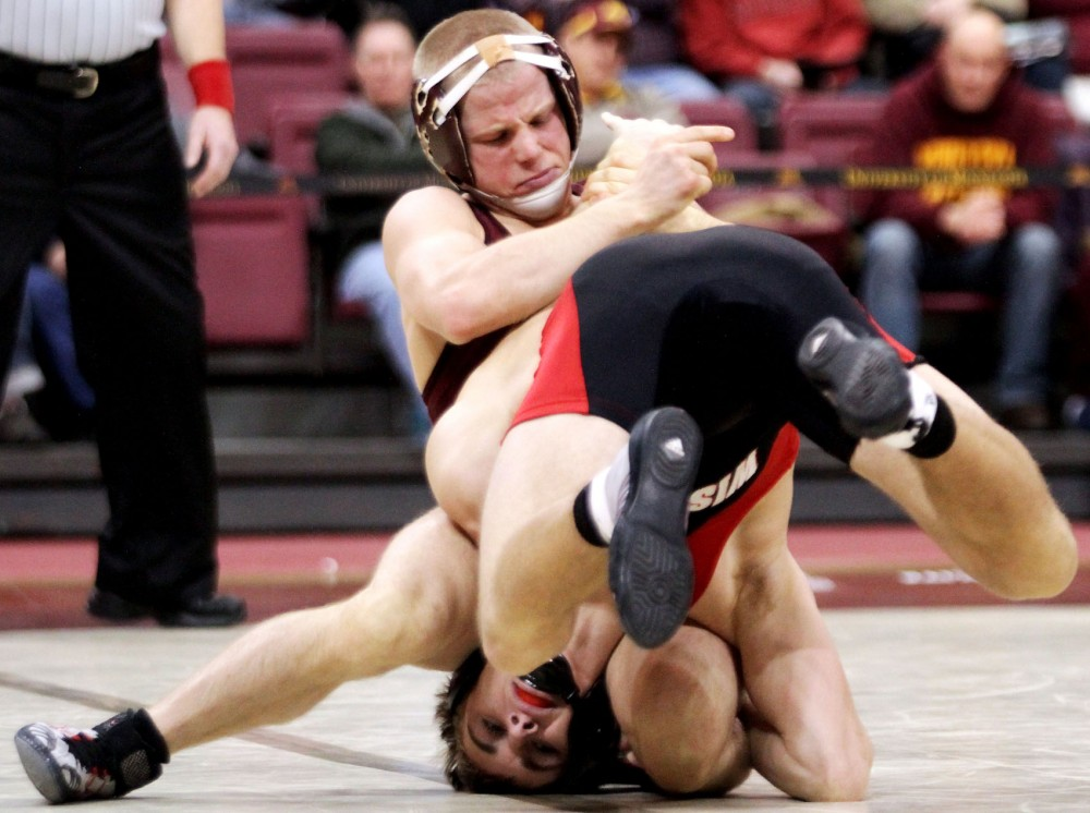Zach Sanders wrestles Wisconsin's Austin Hietpas on Jan. 22 at the Sports Pavilion. Sanders will compete for a spot on the U.S. Olympic Team roster this weekend.