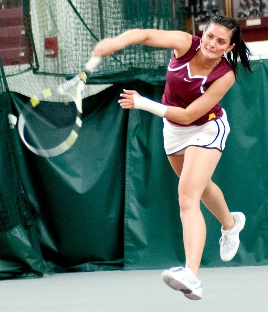 Freshman Julia Courter serves the ball April 22 at the Baseline Tennis Center.