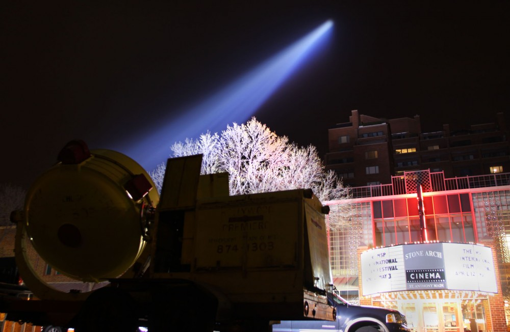 Dave Bourn's spotlight lights up the sky above St. Anthony Main theater for the opening of The Minneapolis St. Paul International Film Festival Thursday night.  Bourn's company, Hollywood Premiere, boasts a 800 million candle power, World War II era anti-aircraft spotlight as part of their arsenal.