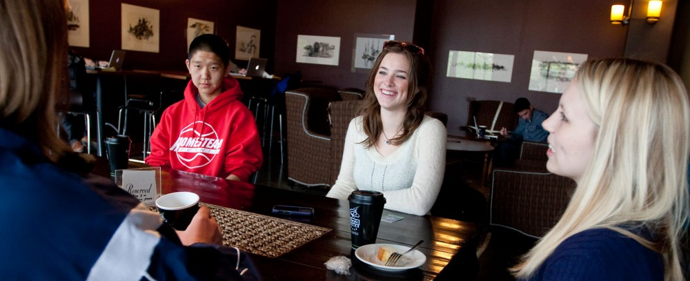 From left to right, sophomore Kevin Zhou, psychology junior Bridget McGuinness and family social science junior Sarah Day hold their regular S.O.B.E.R. student group meeting April 19 at the Purple Onion.