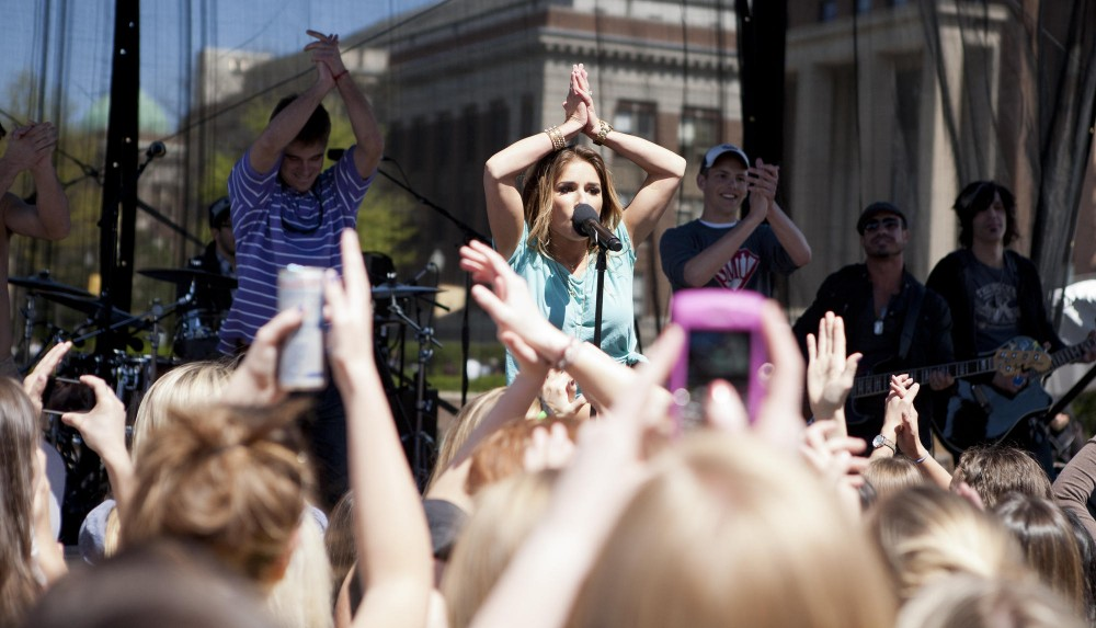 Jessie James, a country-pop singer, performs to a crowd at the 2012 Spring Jam concert April 20 on the front plaza of Coffman. James did not headline the festival but the University paid $15,000 for her performance.