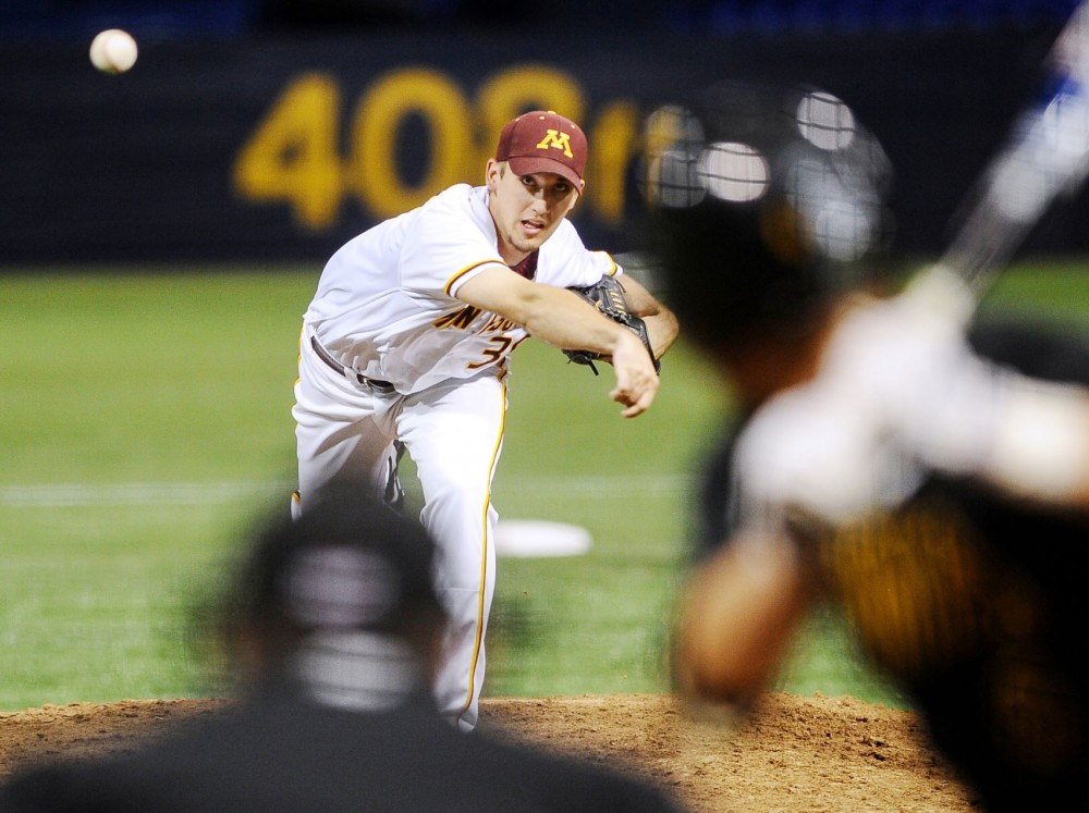 Minnesota pitcher TJ Oakes throws against Iowa on April 27 at the Metrodome.  Oakes leaves the Big Ten in innings pitched, ERA and strikeouts.