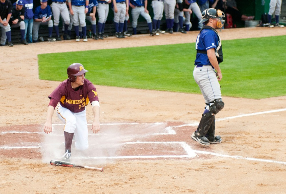Minnesota outfielder Andy Henkemeyer slides into homeTuesday night at Siebert Field. The Gophers won 9-2 against St. Thomas during last game at Siebert Field.