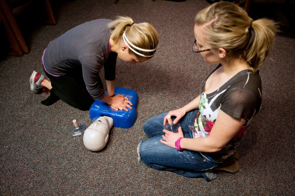Nursing students Stephanie Price and Heather Hanney review CPR techniques during a CPR Health Care Provider Recertification course Monday at Boynton Health Service.