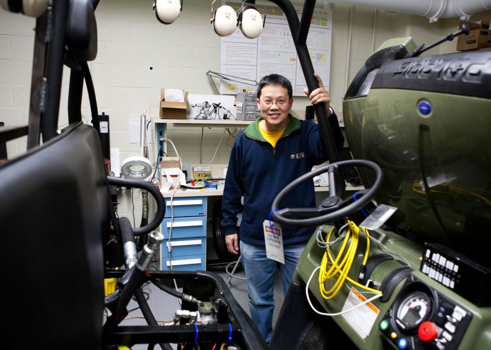 Mechanical engineering professor Perry Li stands in the hydraulic hybrid vehicle that inspired his isothermal compressed air energy storage system Monday in the Mechanical Engineering building.