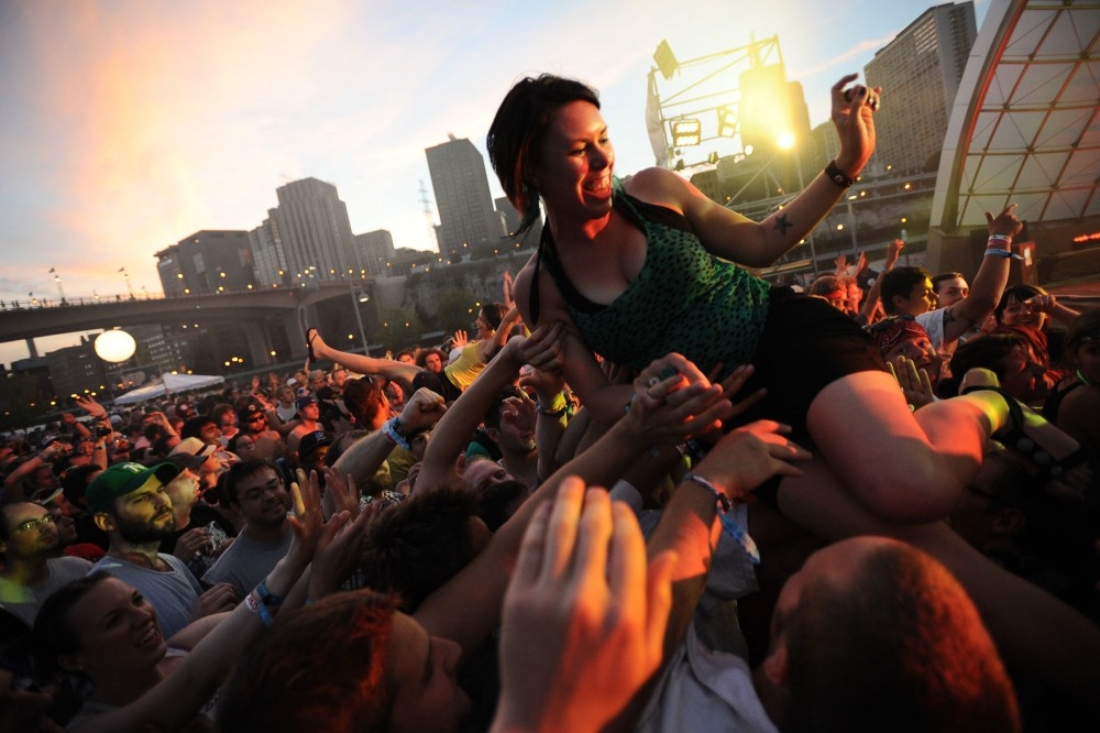 Holly Marie of Des Moines, Iowa crowd surfs during Diplo's set Sunday at River's Edge Music Festival in St. Paul, Minn.