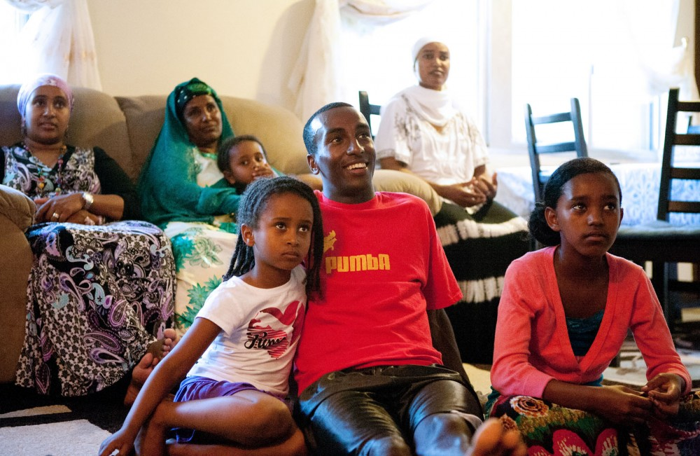 Harun Abda watches a movie with his family Monday afternoon at their home in St. Paul. Abda will be competing at the U.S. trials over the next week to qualify for this summer's Olympic Games.