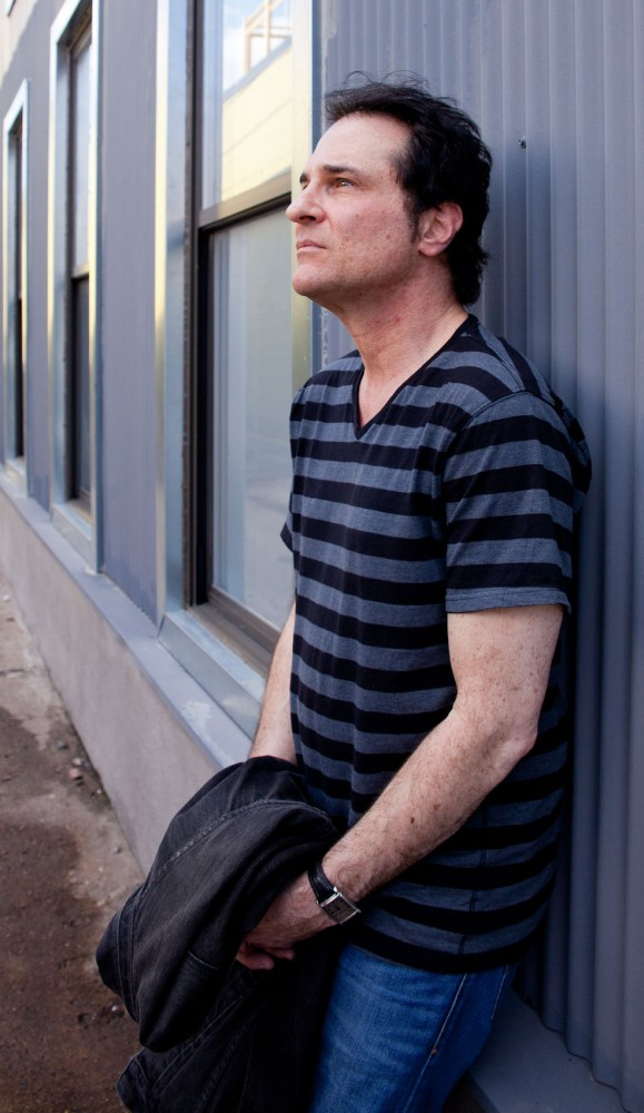 Songwriter and musician Kevin Bowe poses for a portrait Saturday.
