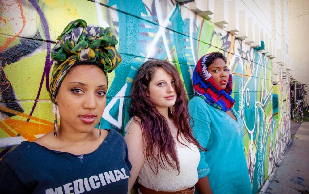 Sophia Eris, Claire de Lune, and Lizzo pose for a portrait Saturday in Uptown.