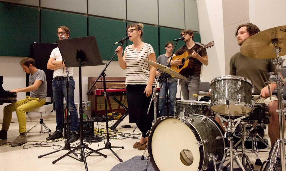 Bandmates Joey Kantor, Peter Sieve, Linnea Mohn, Paul Engels, Chris Koza and Luke Anderson practice Sunday at Ferguson Hall. They will perform at Works for Words on Friday at the Fitzgerald Theater in St. Paul, Minn.