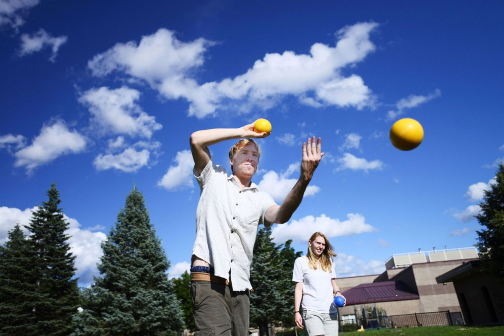 Student liaisons Jonathan Buetner and Carrie Noble play bocce ball during their weekly