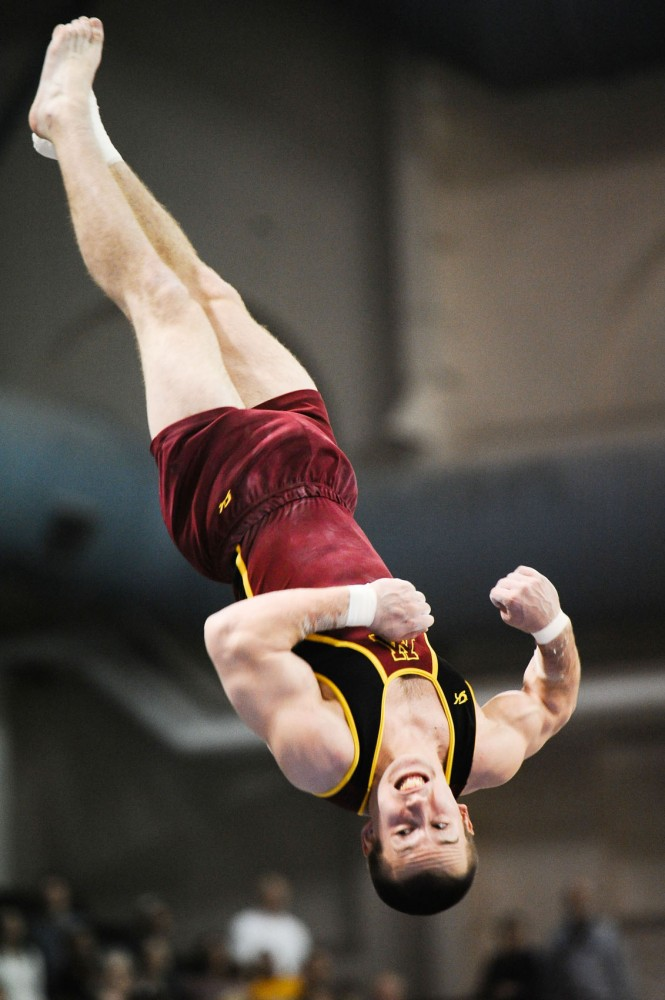 Gophers gymnast Zack Chase vaults March 24 at the Sports Pavilion. Chase will compete at the Visa Championships this week for the opportunity to make the Olympic trials.