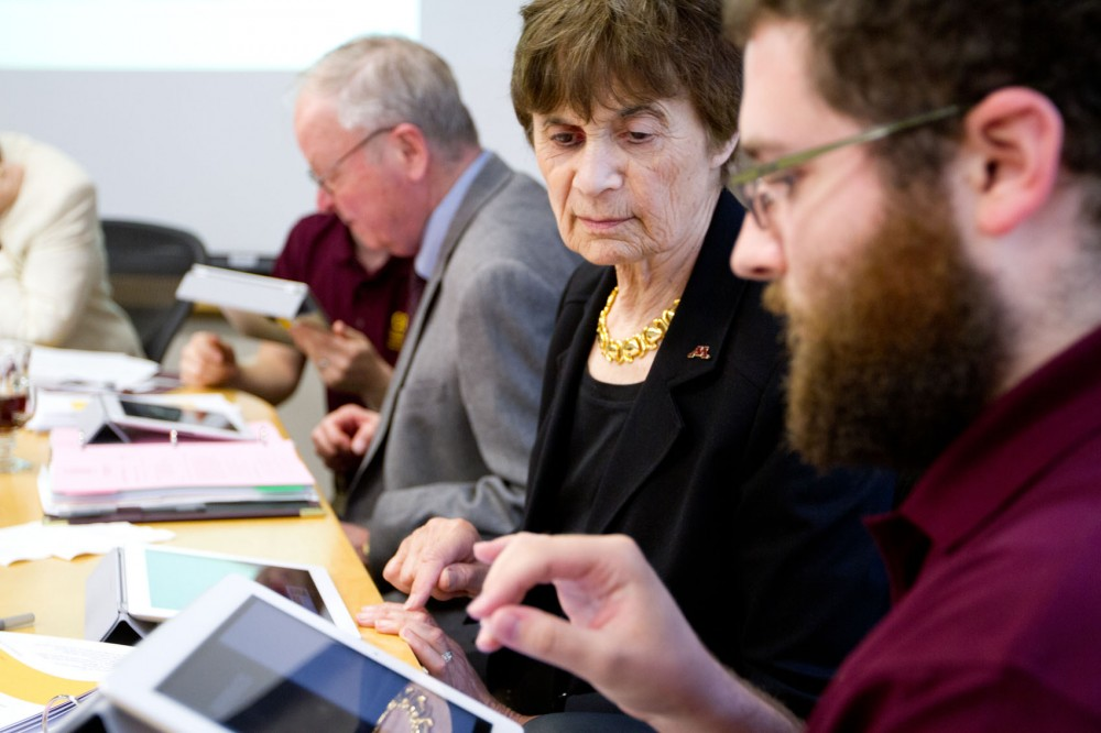 Regent Linda Cohen receives an iPad tutorial from College of Education and Human Development technical coordinator Daniel Ferrara on Thursday during the Educational and Policy Planning Committee meeting at the McNamara Alumni Center. Representatives from CEHD, which has started an iPad pilot program for incoming freshmen, delivered the presentation.