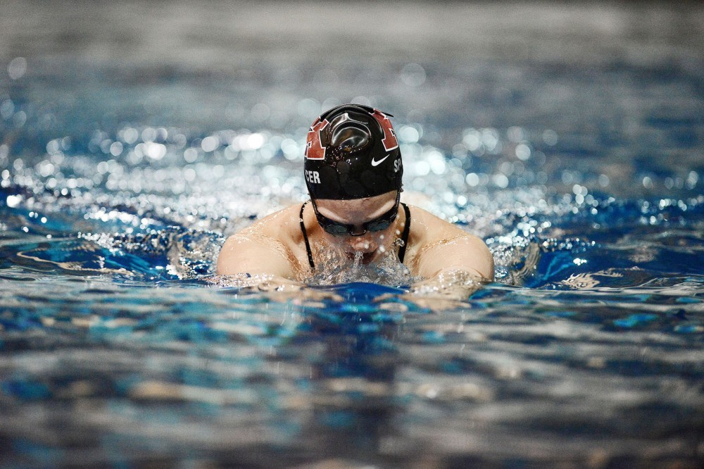 Haley Spencer swims during practice Friday at the Aquatic Center. Spencer is competing in the 100 and 200 meter great stokes at the U.S. Olympic trials.