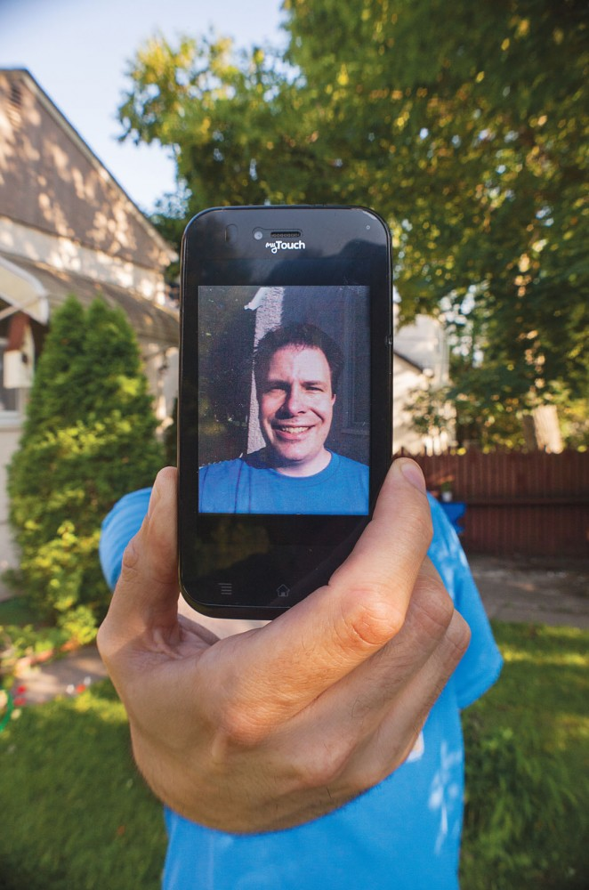 Stuffaboutminneapolis blogger Paul Merill, poses for a portrait at his home on Saturday with his cellphone on which he often uses Instagram.