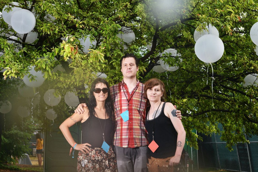Art curator Anna Cerniglia, left, founder of Chicago's Johalla Projects, stands with artists Matthew Hoffman and Andrea Jablonski underneath a balloon installation Saturday in the VIP area of the Pitchfork Music Festival in Chicago. Jablonski and Hoffman contributed the two art installations at the festival.