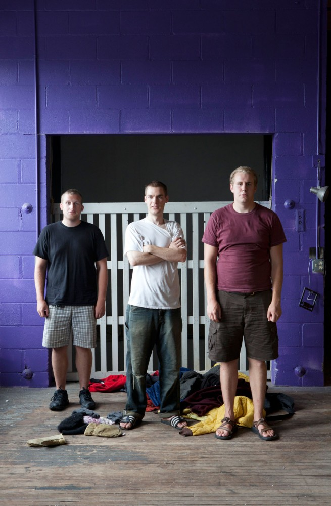 Myndwyrm members Paul Stucker, Billy Mullaney, Peter Rusk pose for a portrait Thursday in their downtown rehearsal space.