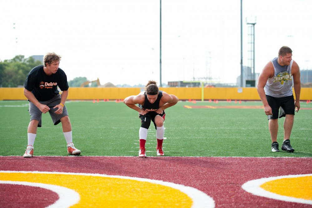 Garrett Shelley, center, conducts drills at the Bierman Field Athletic Building on Friday during Larry Fitzgerald Jr.'s summer camp.