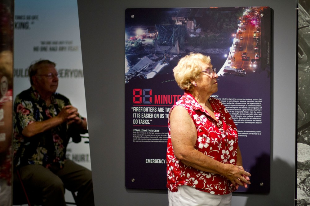 "Gail Baerg from Brooklyn Park reaches the end of ""81 Minutes: After the Bridge Collapsed"" exhibit Sunday at the Firefighters Hall and Museum in Northeast Minneapolis. The exhibit takes visitors from minute 0 to 81 following the collapse of the I-35W bridge five years ago."