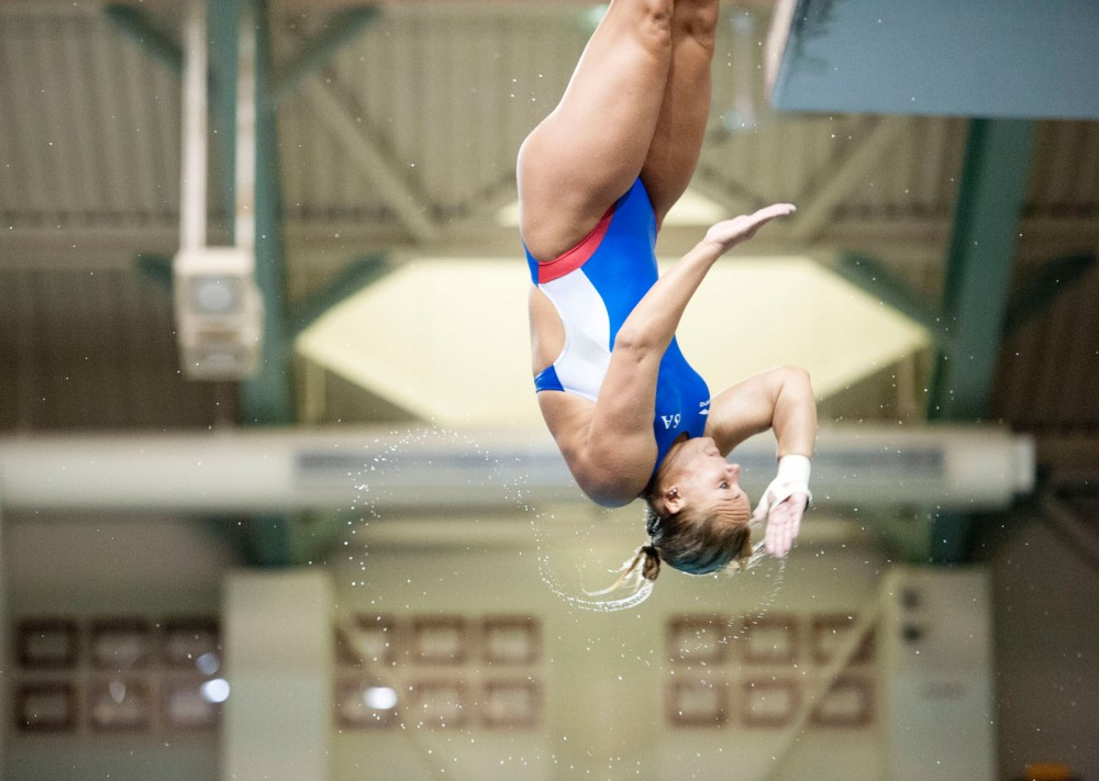 Kelci Bryant practices her 1-meter springboard dive July 2 at the University Aquatic Center. Bryant will be competing for the United States at the Olympic Games in London this summer.