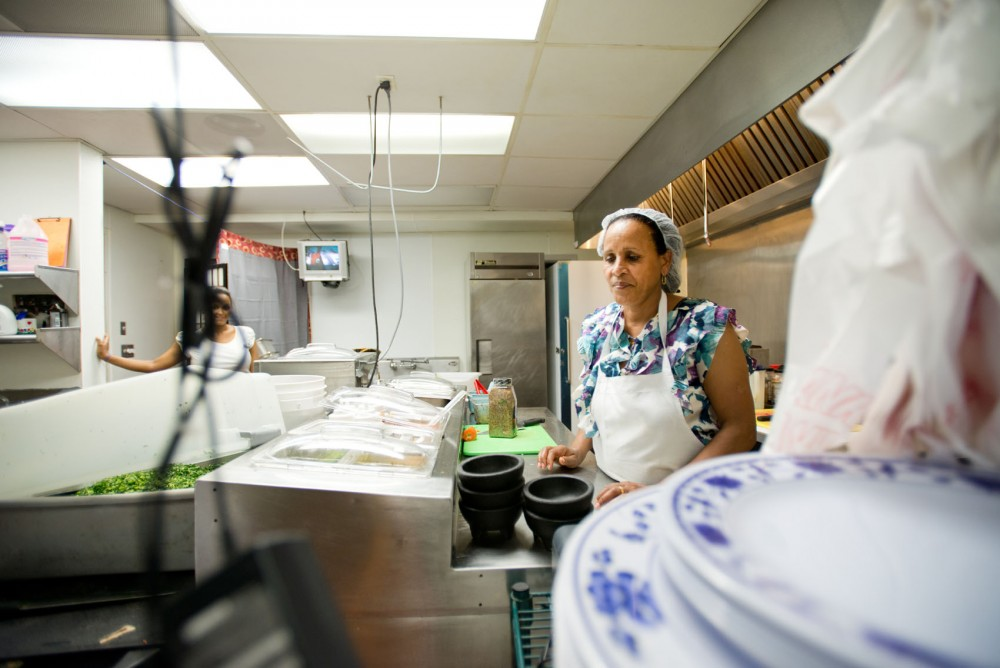 Owner Beko Tufa works in the kitchen of her newly opened restaurant, Dilla's, on Saturday.