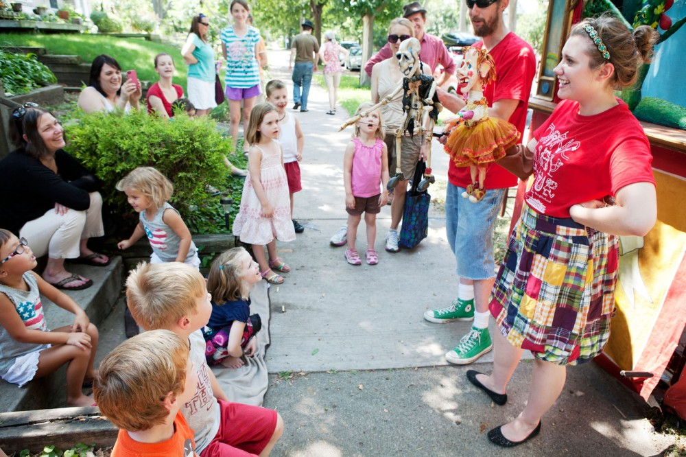 """Kevin Long and Lauren Haven give the audience a closer look at the puppets after their show """"""""The Adventures of Katie Tomatie"""""""" on June 30 in south Minneapolis. The Driveway Tour will be presenting three different shows in neighborhoods through Aug. 7."""