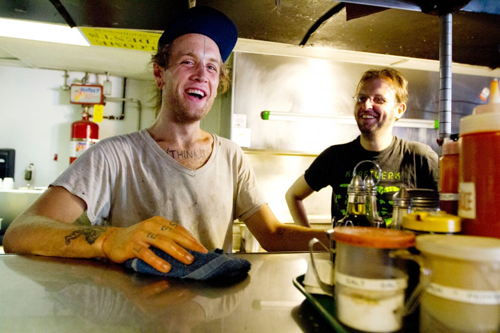 Cook Nickolas Kimble, left, and barista Arik Xist work a shift Friday at Hard Times Cafe in Minneapolis. The cafe has been operating as a collective for 20 years.