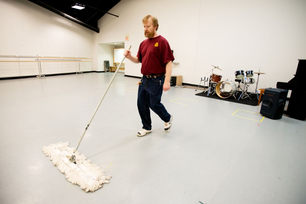 Sr. Building and Grounds Worker Pat Bemrick works the night shift Sunday at the Barbara Barker Center for Dance.