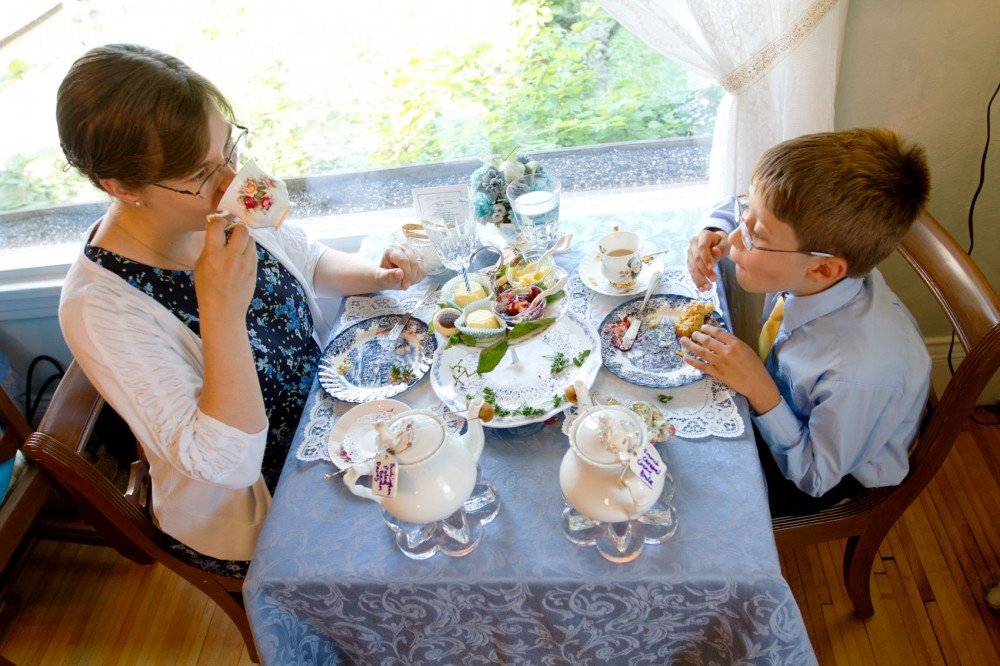 Angella Hanson and her son Douglas sip tea and nibble pastries on Thursday at Lady Elegant's Tea Room & Gift Shoppe in Milton Sq. Hanson brought her son to the tea room to celebrate his ninth birthday.